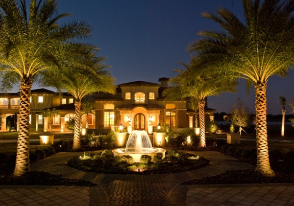 fountain and palm lighting in large garden setting