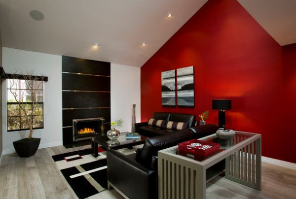 Accent wall in red lights up the living room
