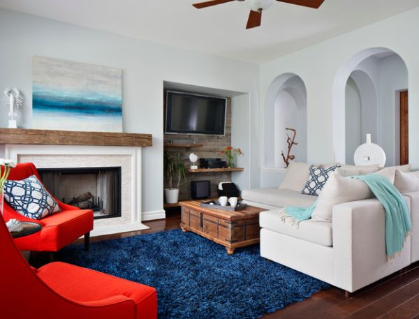 Art work above the fireplace accentuates the coastal look