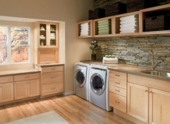 Beautiful laundry room with ample storage and shelving room