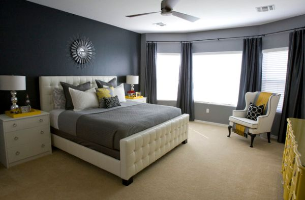 Bedroom in grey with sunny yellow splashes spread around