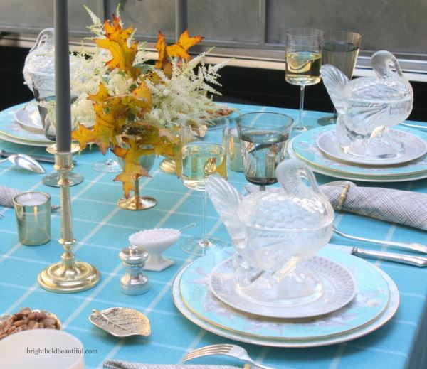 Blue fall table setting with a dash of yellow