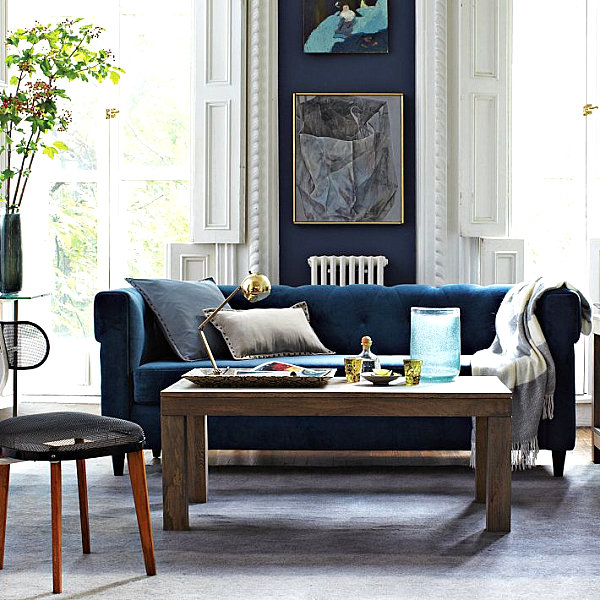 Blue tufted upholstered sofa