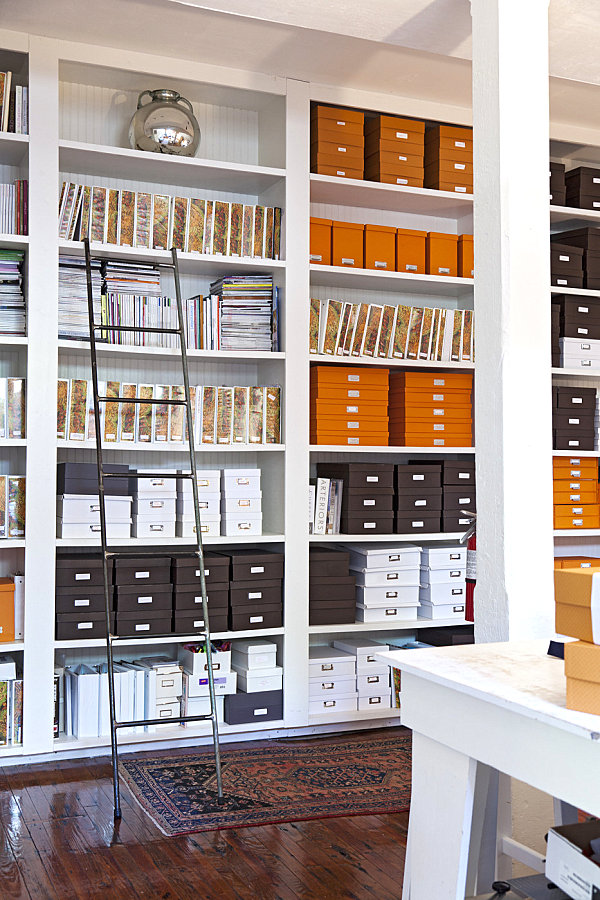 Boxes and binders in a beautifully organized office space