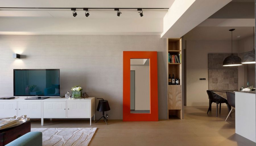 Bright orange mirror frame in the living room