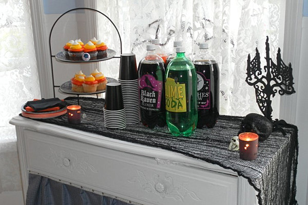 Cheesecloth runner for a Halloween party spread