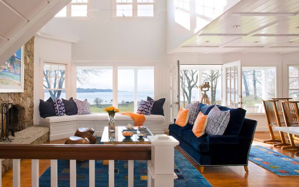 Coastal living room with bright pops of orange