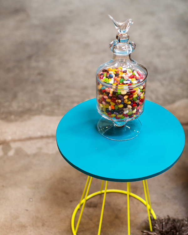 Colorful jelly beans on a blue and yellow table