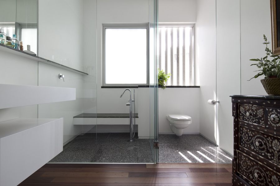 Contemporary bathroom with glass walls