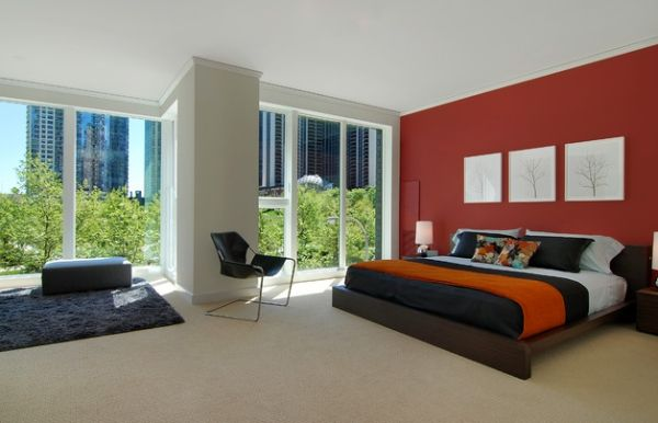 Contemporary bedroom with a red accent wall