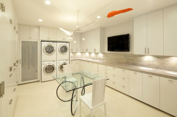 Contemporary laundry room comes with entertainment options as well!