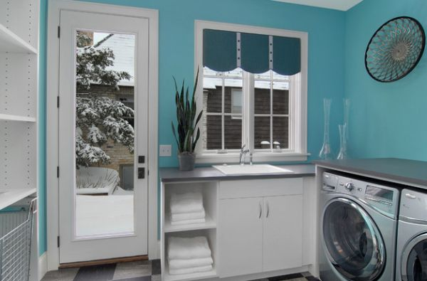 Cool turquoise combined with pristine white in the modern laundry room