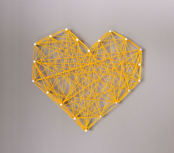 DIY threaded string heart in yellow