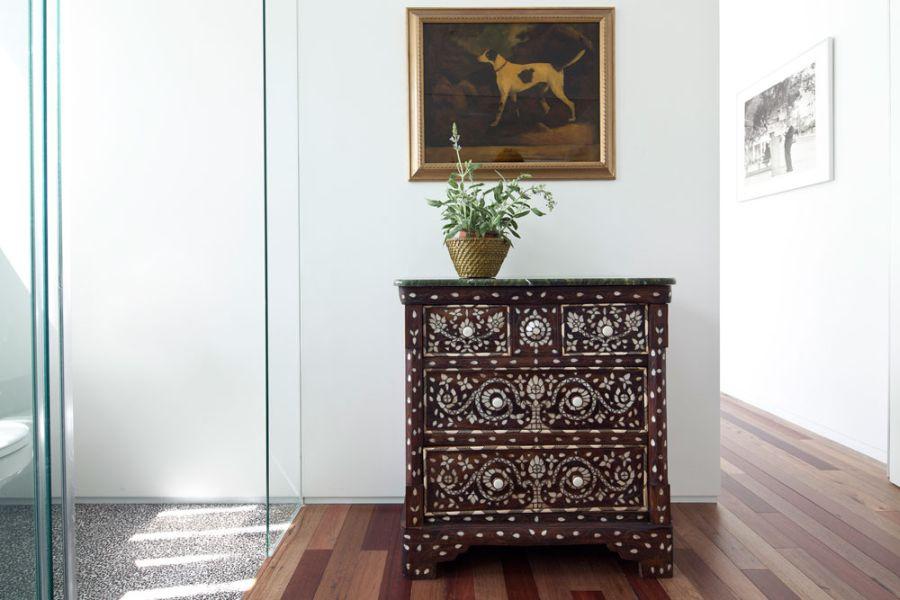 Damascene style dresser in the hallway
