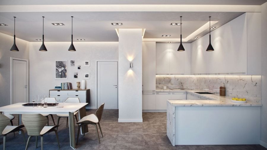 Dark pendant lights in a light and airy kitchen