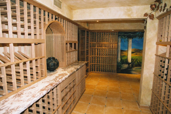 Dominican design wine cellar with mural and marble counter