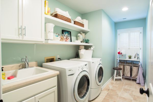 Ergonomic laundry room design with beautiful white shelves