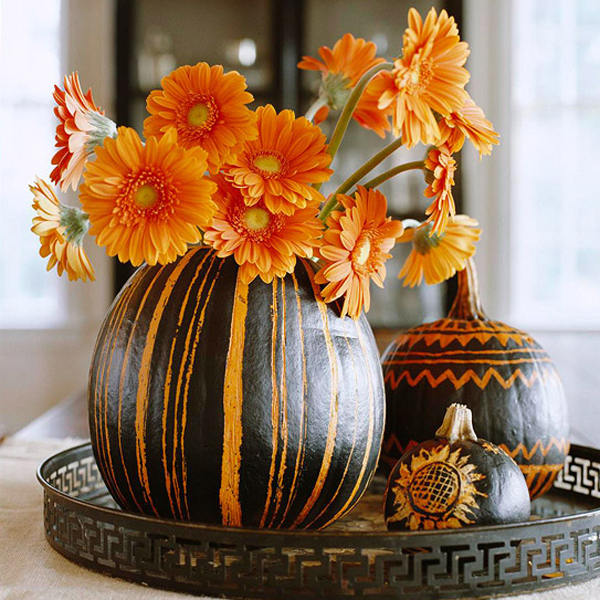 Etched pumpkin design using black paint