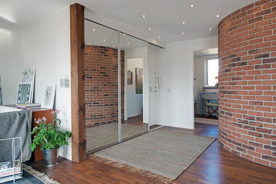 Exposed brick wall and sliding glass doors