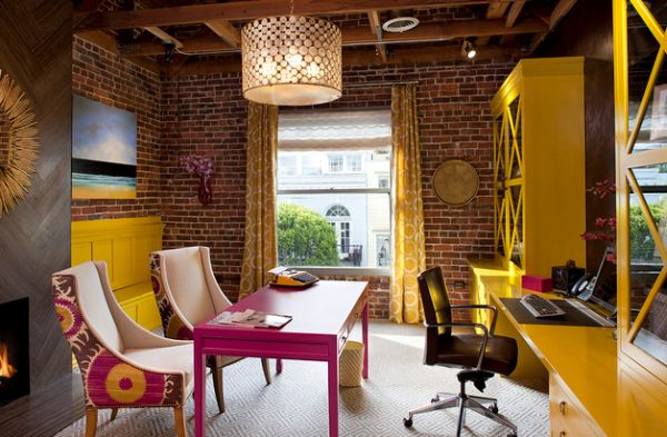 Exposed brick walls and fabric chairs create an inimitable work area