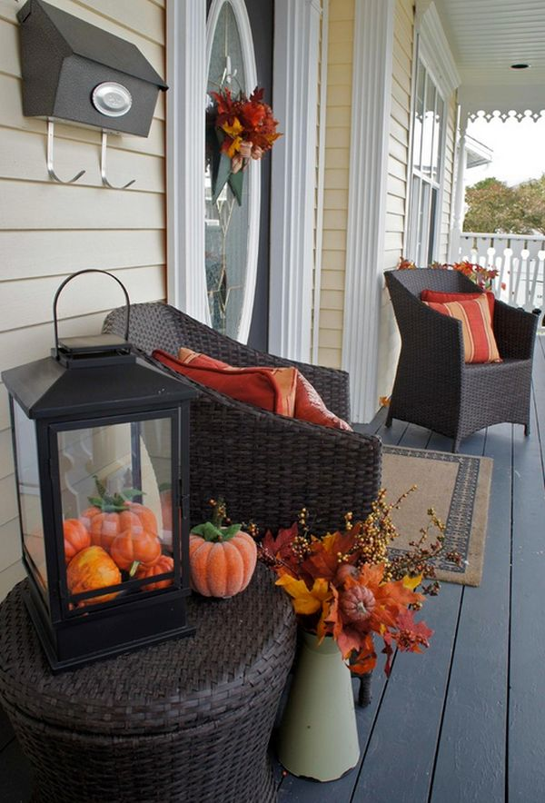 Fall porch decorations can be easily transformed into Halloween themed decor