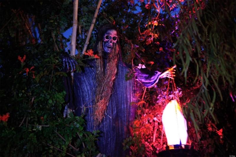 Frightening bony body lit from below with skeleton