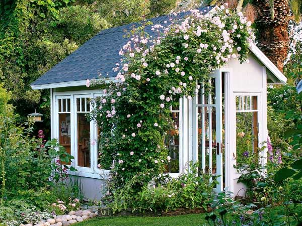Garden cottage with beautiful blooms Garden Cottages and Small Sheds for Your Outdoor Space