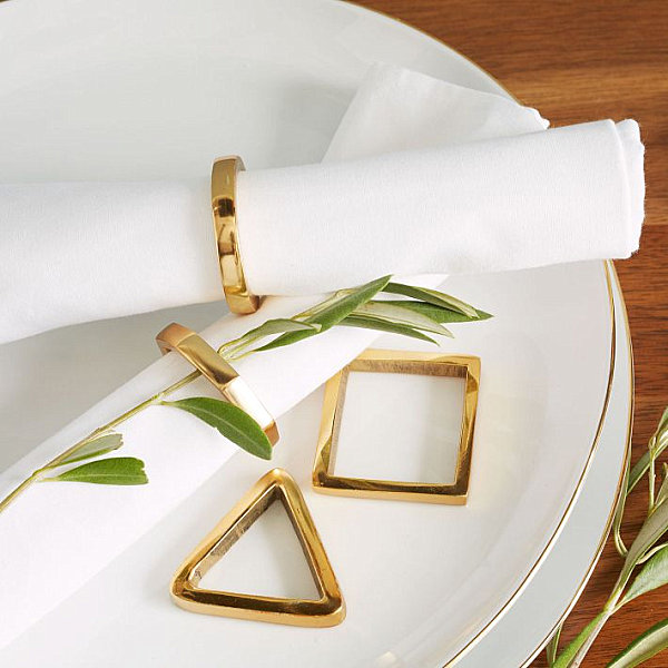 Geometric gold napkin rigs
