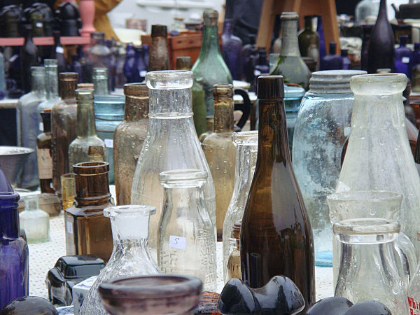 Glass bottles on an antique show table