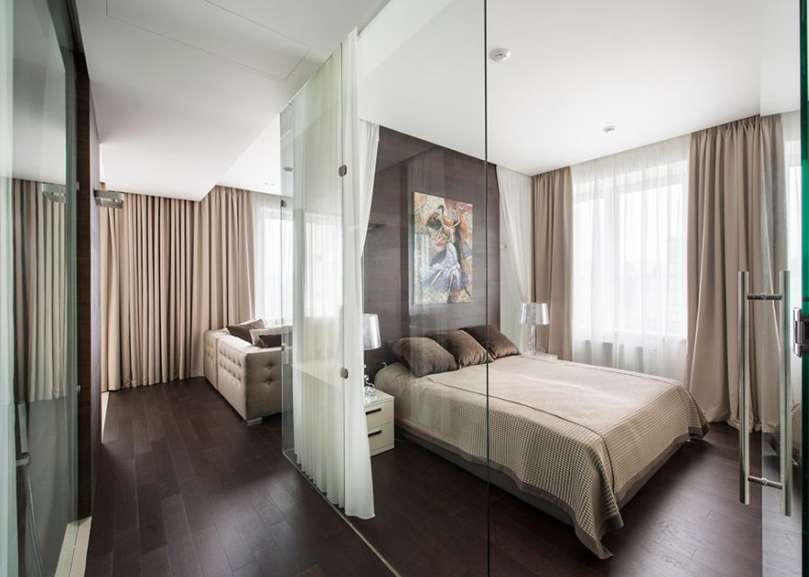 Glass doors lead into the bedroom