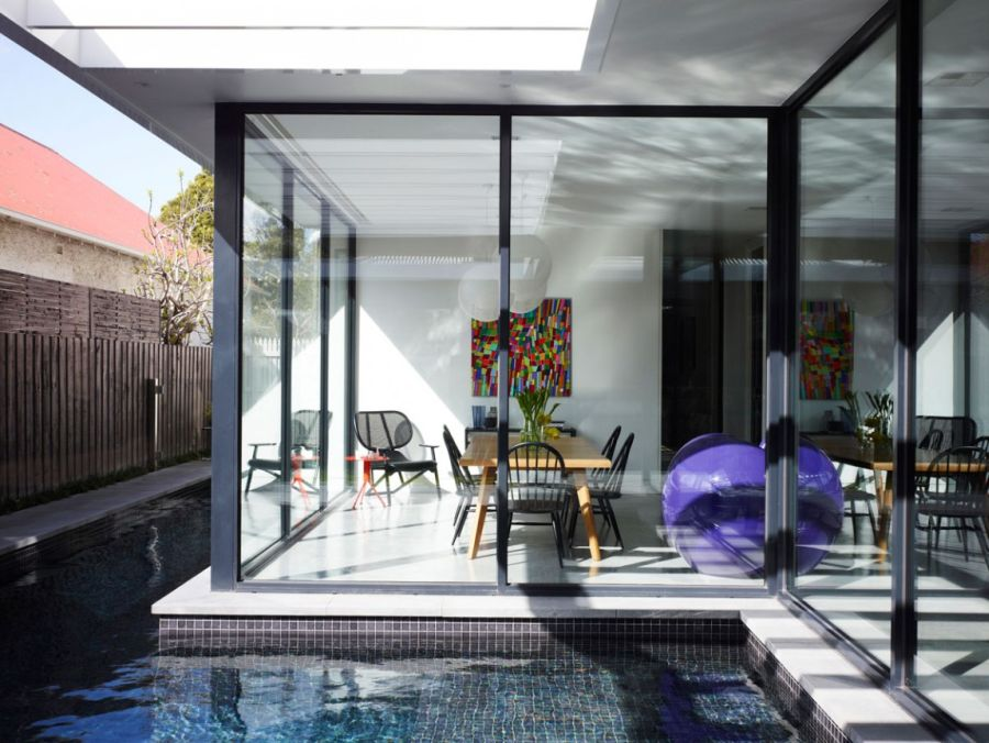 Glass walls present an open interior Cool Melbourne Renovation Charms With A Crisp And Colorful Interior