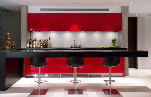 Glossy red kitchen cabinets combined with industrial design