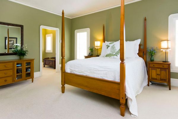 Green and white help create a luxury retreat vibe in the bedroom