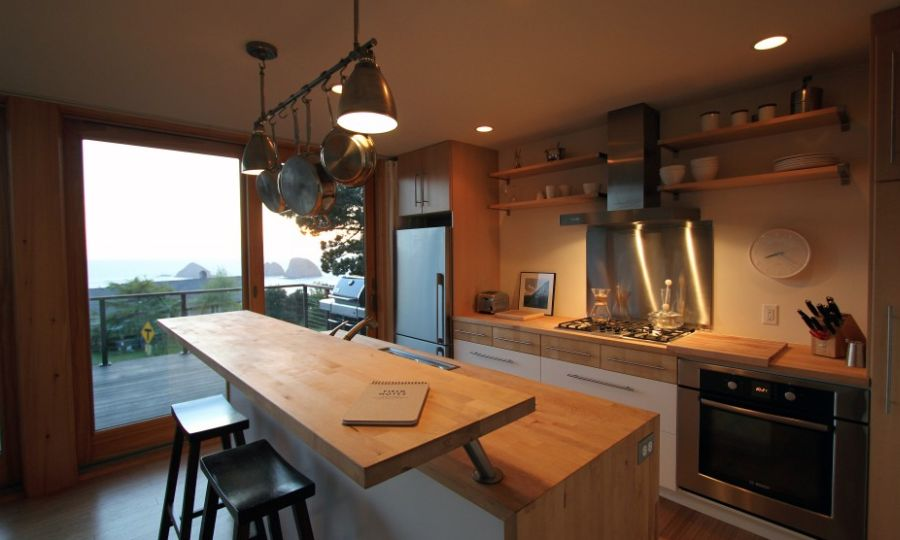 Kitchen domintade by wooden surfaces