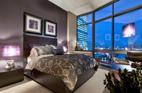 Lamp shades add to the purple hues of the bedroom