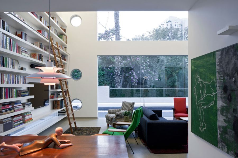 Large bookshelf and display in the living area Transparently Brilliant Tel Aviv Villa Showcases An Open And Airy Design