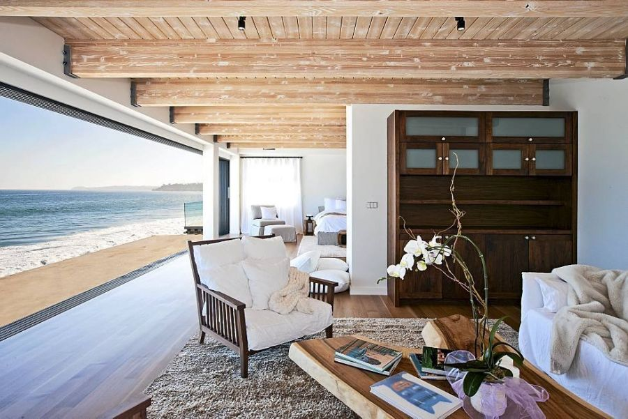 Large glass window offers ocean views