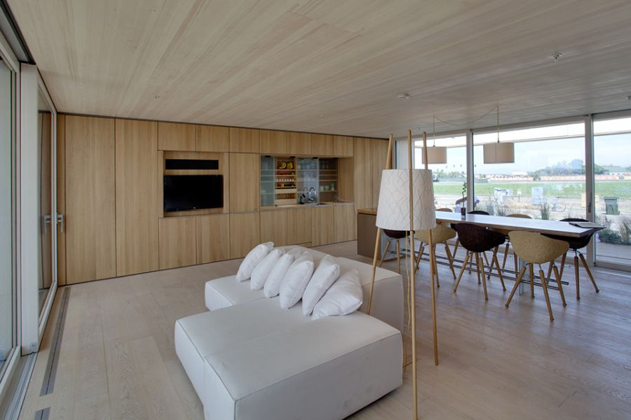 Lovely living room of sustainable solar home from Team Austria
