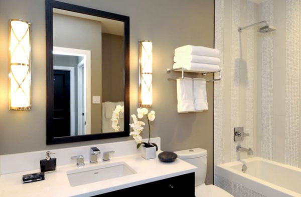 Lovely Towel Display And Wall Mounted Lighting In The Bathroom