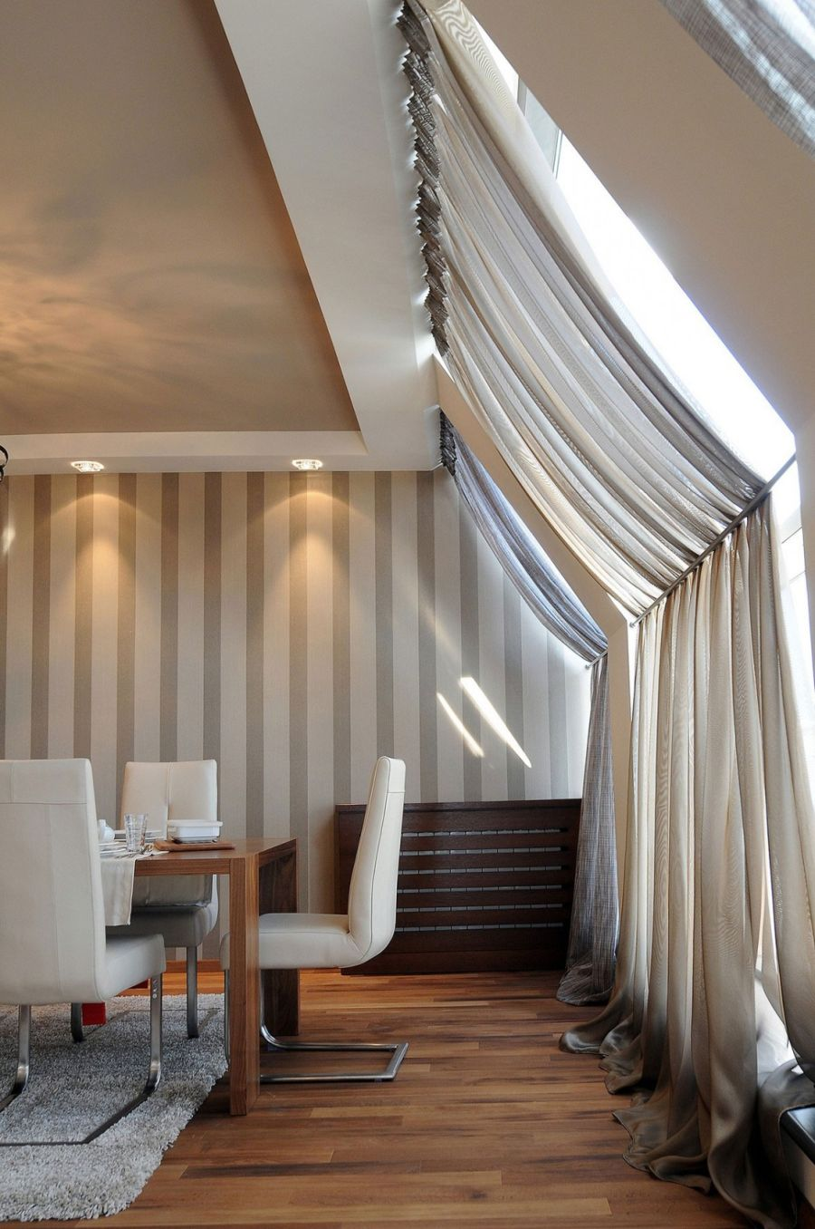 Lovely use of drapes in the dining space