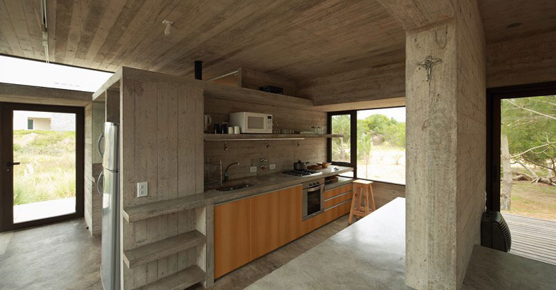 Modern kitchen in concrete and wood