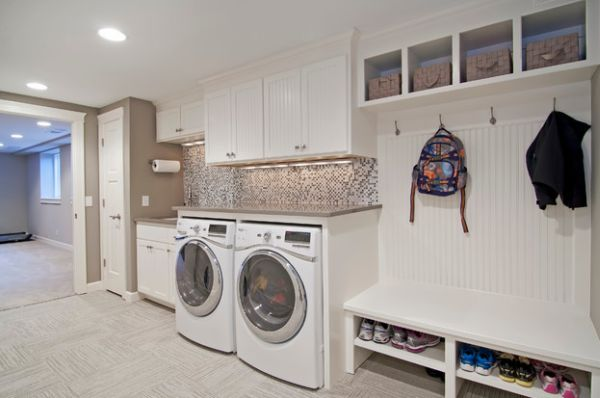 Mud room and laundry combo with a lovely backsplash and cool shelves