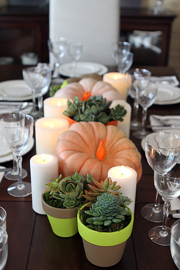 Neon pumpkin and succulent table setting