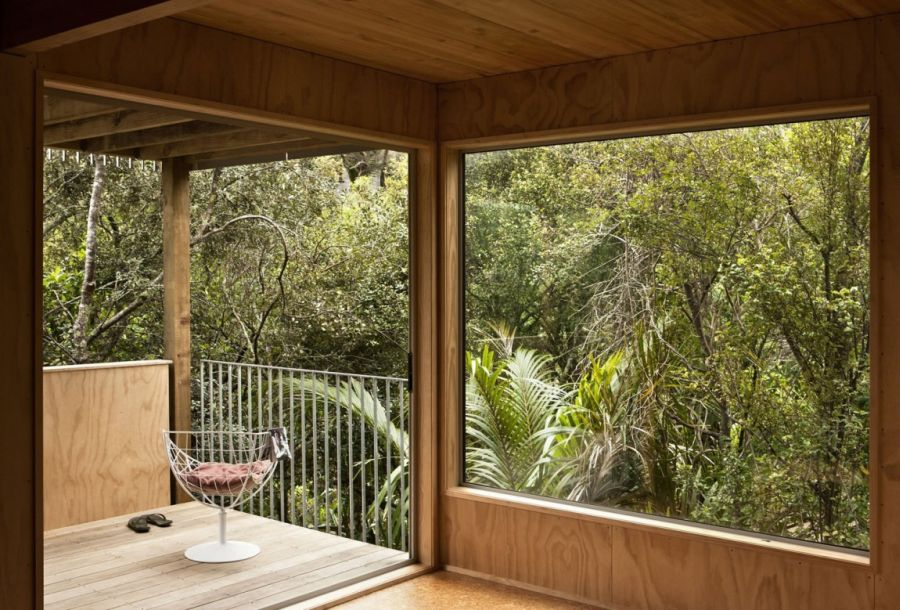 Open interior and large windows of the New Zealand home