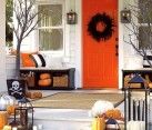 Orange accent door drives home the theme