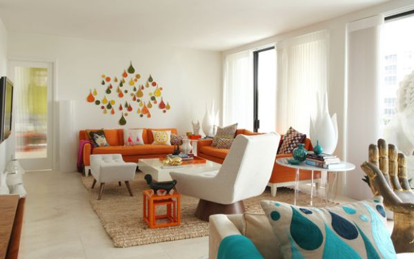 Orange works brilliantly in a coastal styled room when used in sober fashion