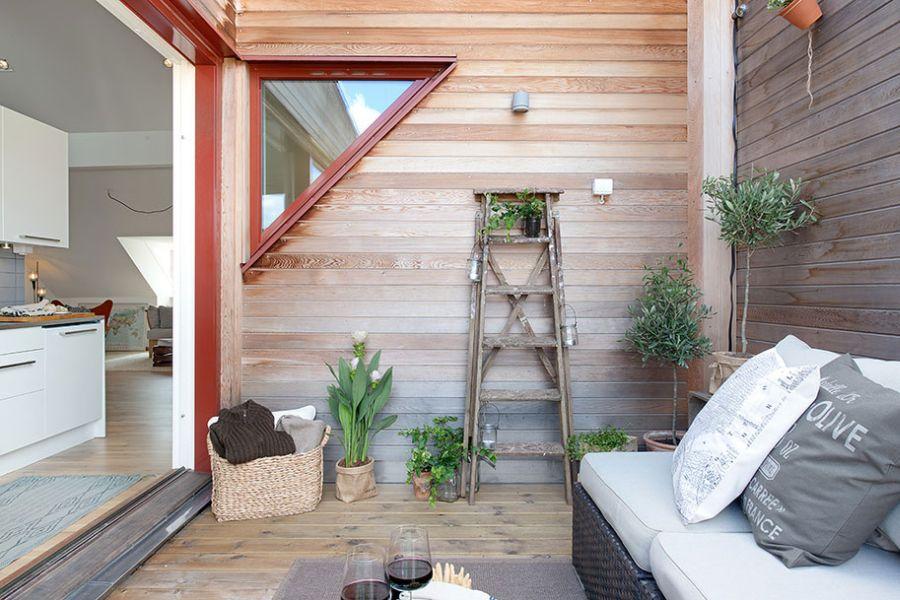 Outdoor seating area in Scandinavian apartment