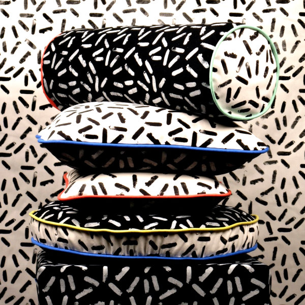 Pillows featuring a Sottsass-inspired print