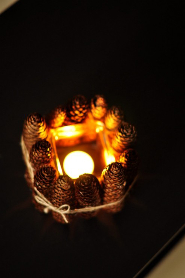 Pine cone and glass candle holder