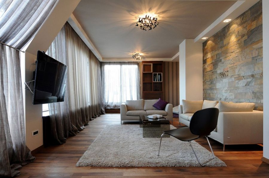 Plush seating in the penthouse living room Exclusive Belgrade Penthouse Combines Dynamic Design With Plush Décor